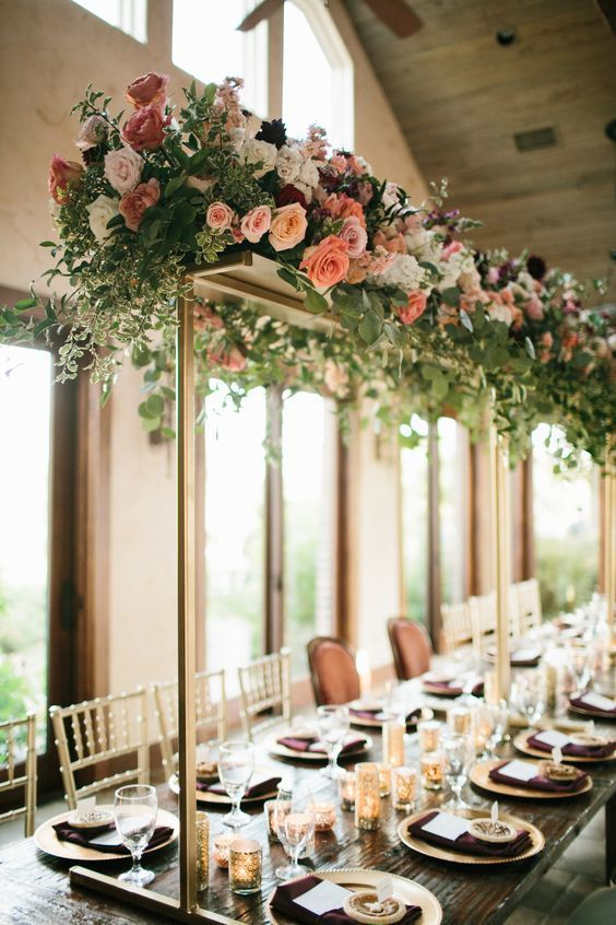 Coral and blush with greenery trellis tall wedding