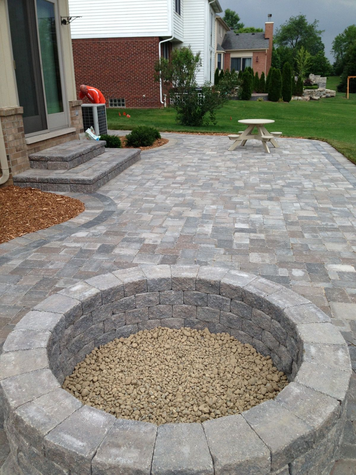 Stone Patio I like the fire pit and how it is open to the