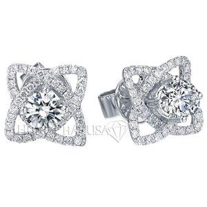 Vỏ Đôi Bông Tai Kim Cương E1359 Vỏ đôi bông tai kim cương tuyệt đẹp này được làm bằng chất liệu vàng trắng 18k với 96 viên kim cương tròn trong suốt hoàn hảo, nặng tổng cộng 0,54 carat. Có thể gắn vừa hột 5.0MM