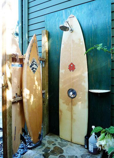 An Outdoor Shower Made Of Surfboards Used Surfboards Beach