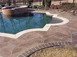 stamped concrete pool deck love the use of color and pattern