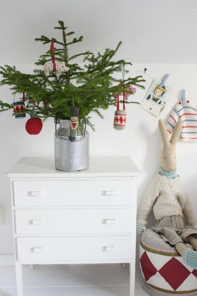 Love the Nordic influence in this room and the very cute tiny tree