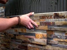 ...stacked stone tile...fireplace? Would love to do this under my Kitchen Bar. I am so doing this!