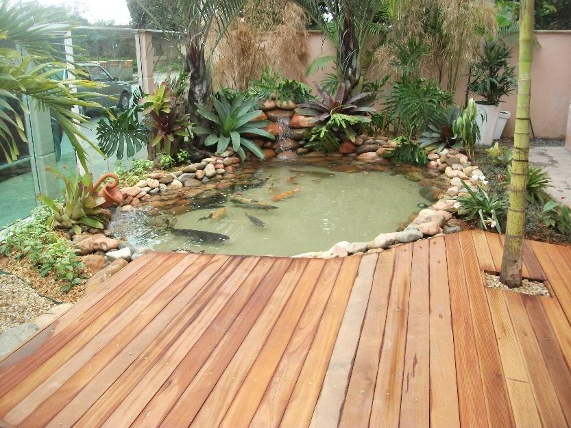 Lago artificial para peixes no jardim modelos for Como construir un lago artificial