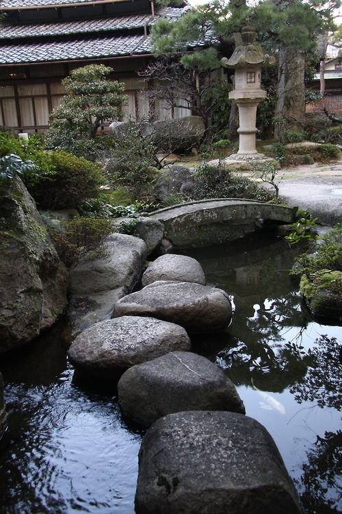 Japanese Garden Stepping Stones And Water.