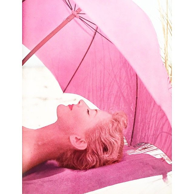 Stay in the shade. Lisa Fonssagrives by Irving Penn.