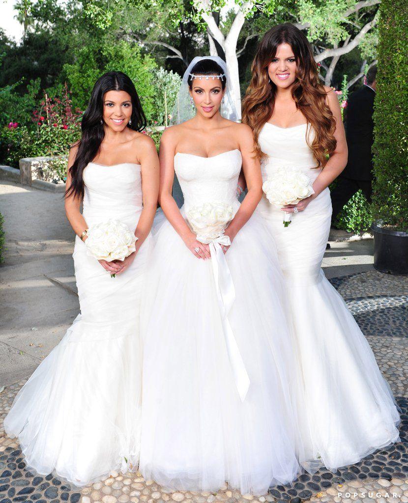 Kim decked her bridesmaids sisters khlo and kourtney in their kim decked her bridesmaids sisters khlo and kourtney in their own white vera wang kim kardashian wedding dresskardashian ombrellifo Image collections