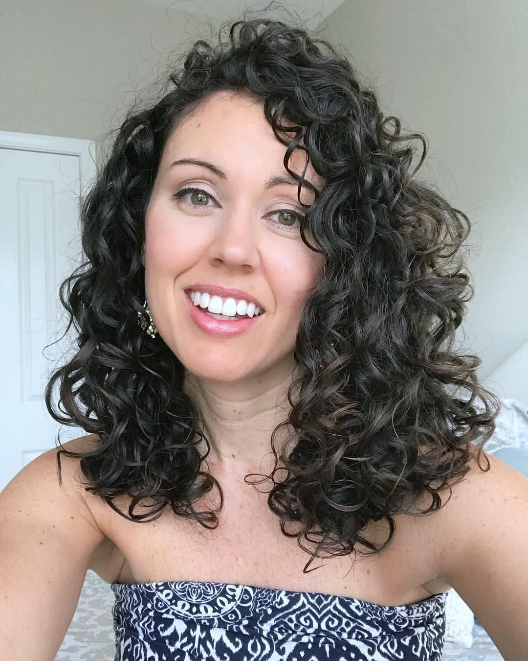 Curly hair styled with products from Shea Moisture and