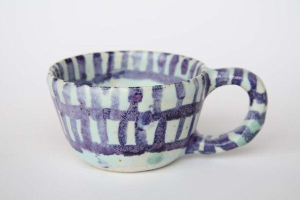 One-of-a-kind sculptural and functional piece by artist Jessilla Rogers. This tea cup has been hand built with stoneware clay and hand painted with multiple gla