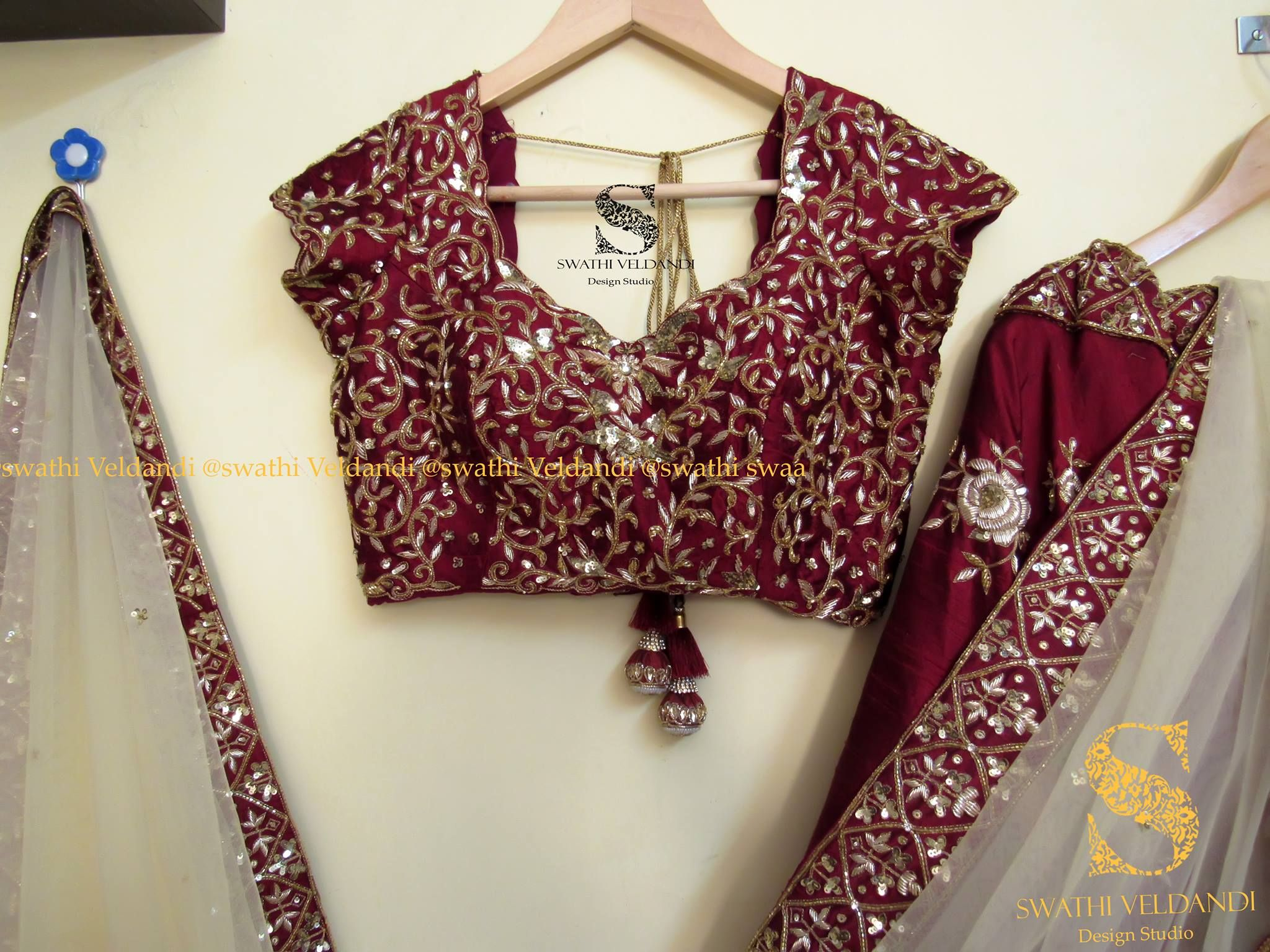 Bridal lehenga in maroon and silver thread work with white net