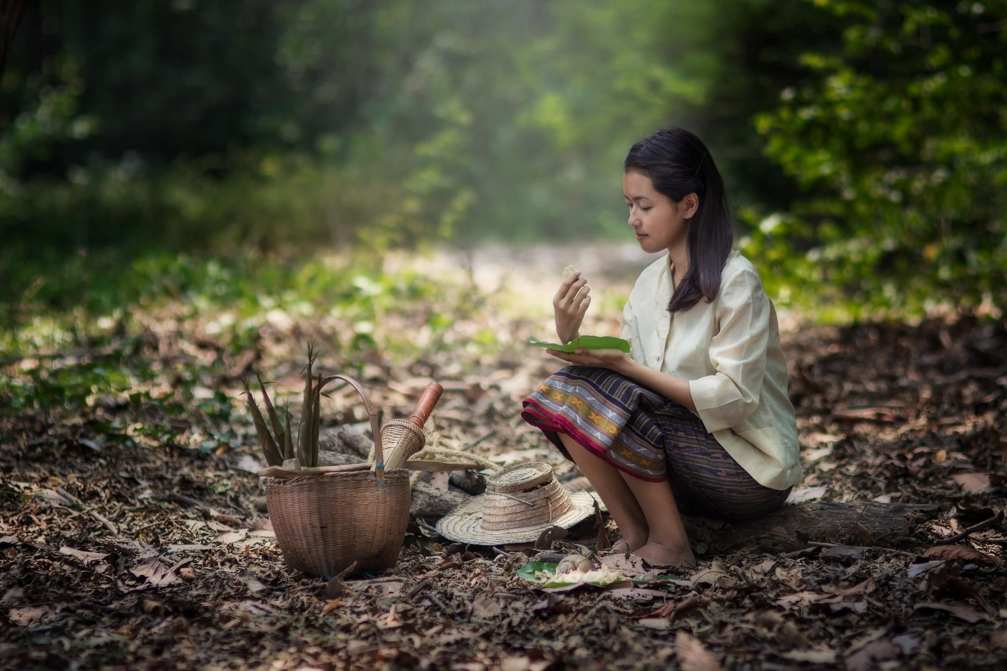 Photograph Thai girl find mashroom by Wichan Sumalee on