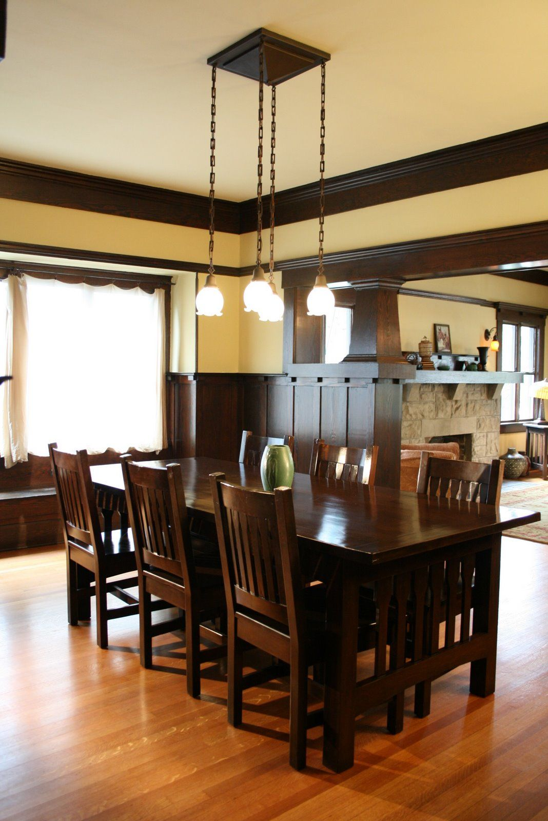 dining room with wainscoting and ceiling beams – 1908 craftsman