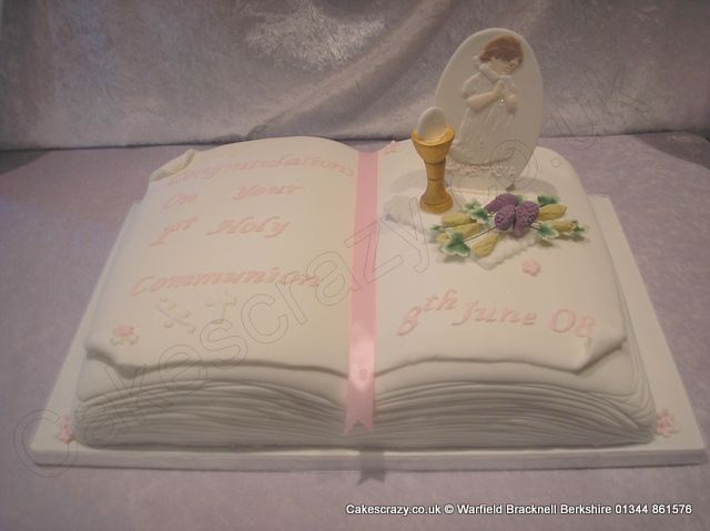 Open book communion cake with challis and wheat sugar models and applique plaque, trimmed in pink
