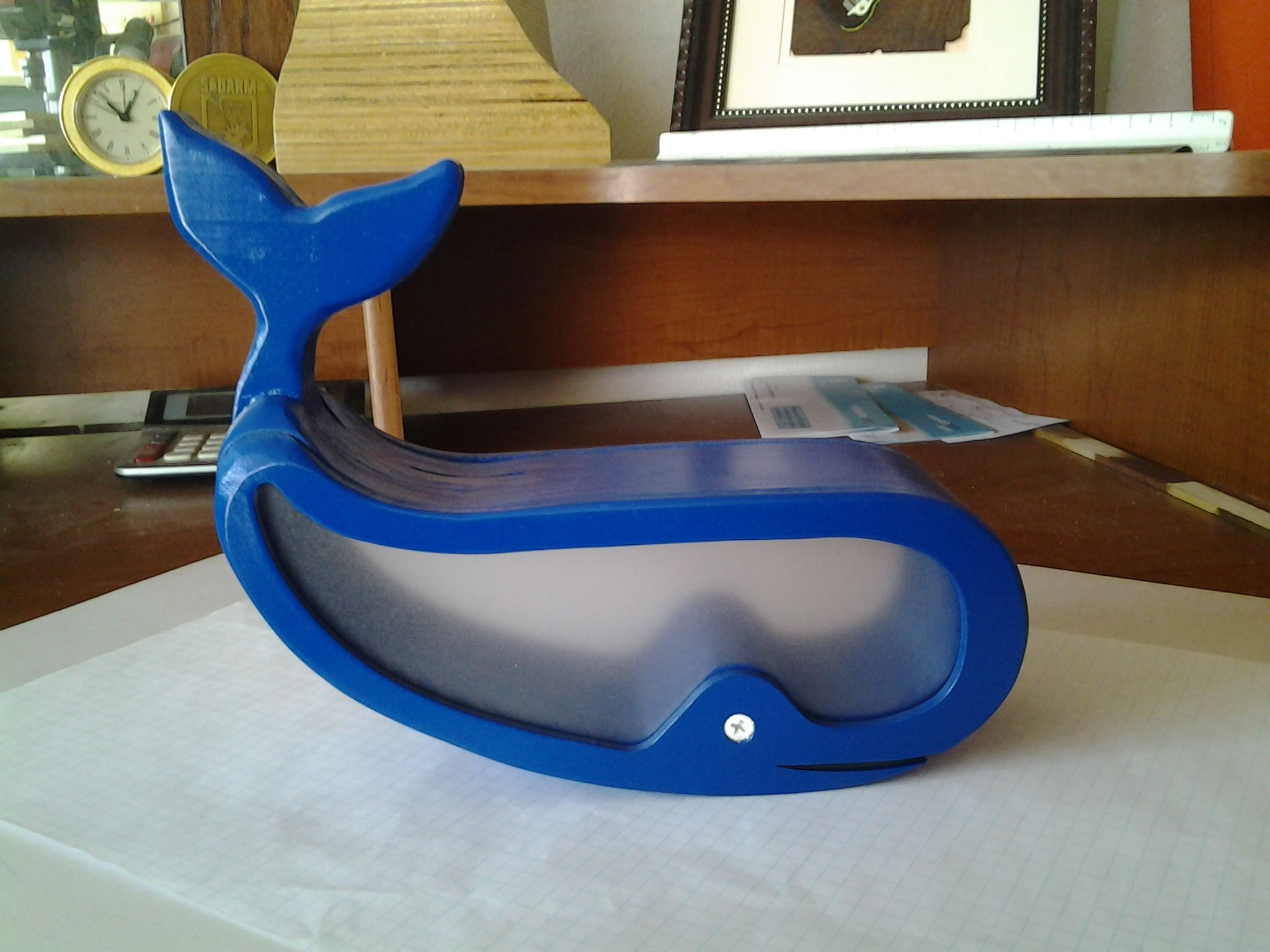 """Whale Bank - 9"""" x 6"""" x 4"""" coin bank. The eyeball is a screw which, when loosened, will allow the back to rotate to empty the bank."""