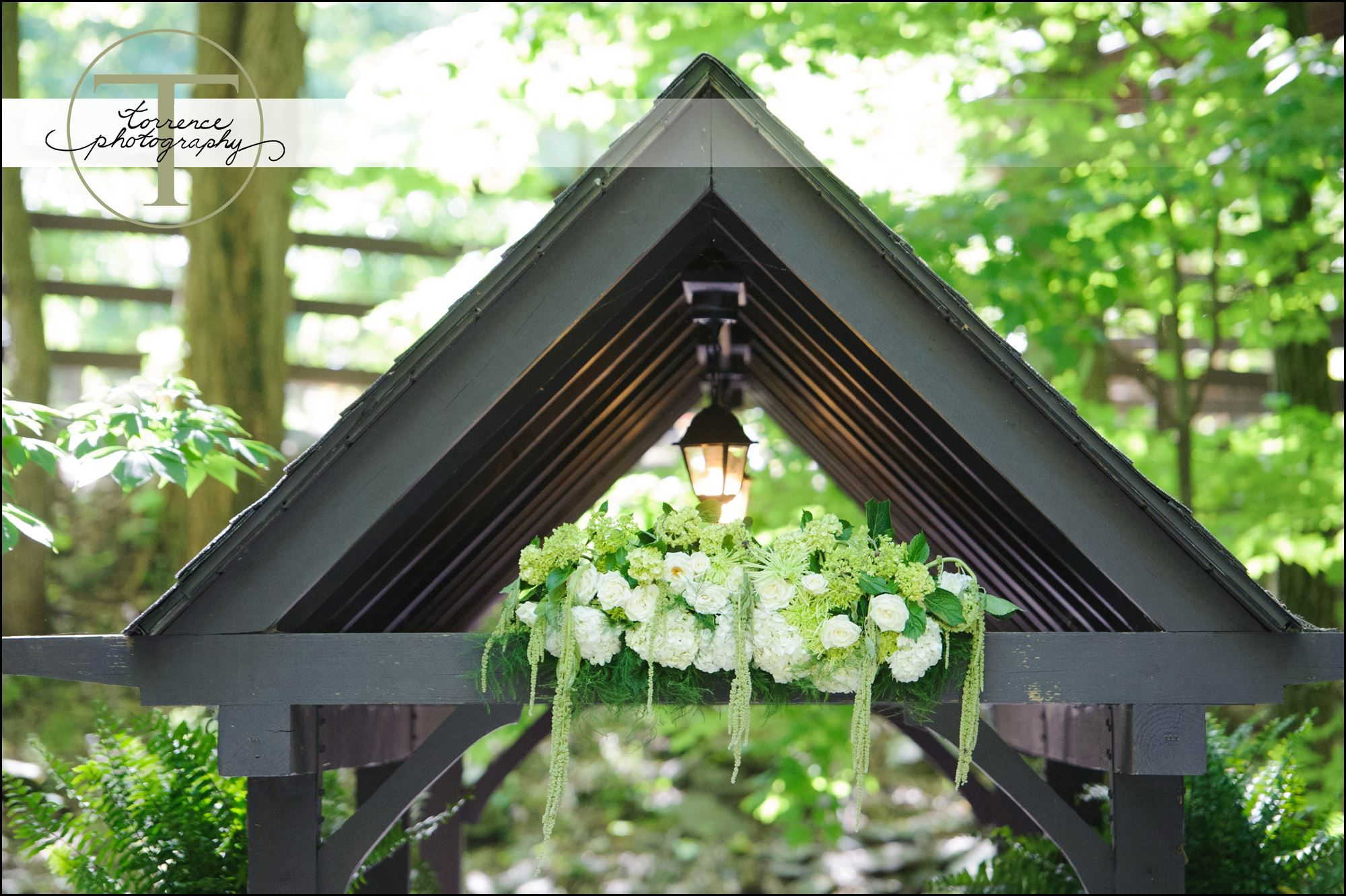 Wedding decorations outside house  Floral decor for this outdoor ceremony at the covered bridge at