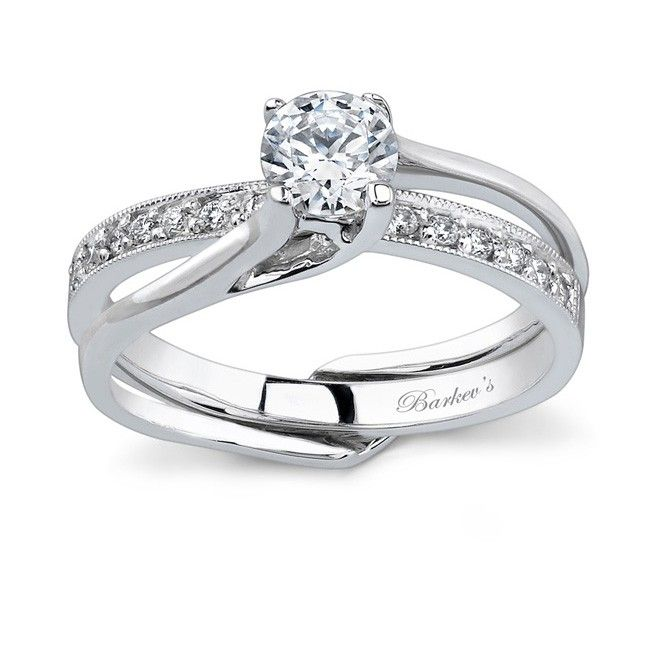 this interlocking diamond wedding set features a solitaire engagement ring with a prong set round diamond center held in the grasp of the swooping - Interlocking Wedding Rings