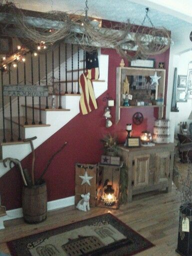 Primitive Entry Way With Old Ladder Wred In Grapevine Hanging From Ceiling