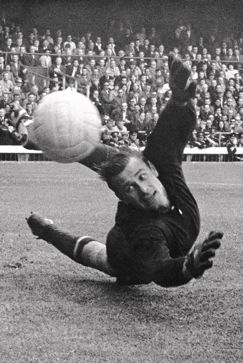 USSR goalkeeper Lev Yashin makes a superb save from Italy s Sandro