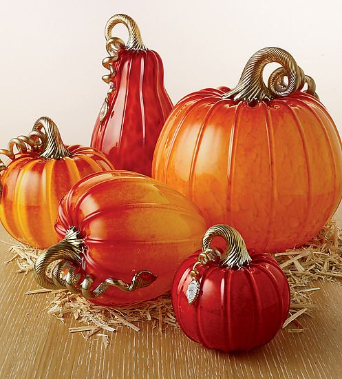 """""""Ruby Pumpkins and Squash"""" art glass sculpture created by #artists Michael Cohn & Molly Stone. In bright ruby and golden tones, the artists explore the beautiful colors of fall in this new series of blown and sculpted glass pumpkins."""