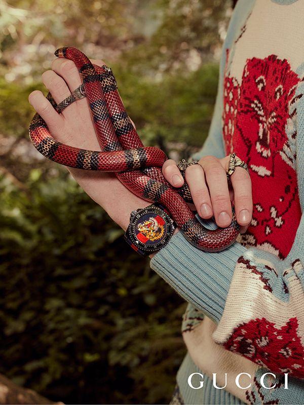 8eb29f15edd Discover more gifts from the Gucci Garden by Alessandro Michele. The tiger  embroidered Gucci Dive watch from Gucci Gift.