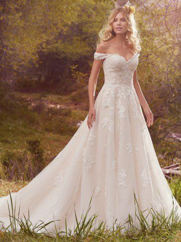 Maggie Sottero - SAFFRON, This timeless yet alluring ballgown features off-the-shoulder sleeves, a V-back, and a sweetheart neckline. Shimmering beads accent delicate cascades of lace along the gown's bodice and tulle skirt. Finished with covered buttons over zipper and inner corset closure.