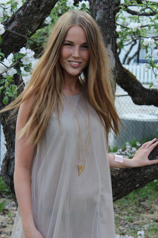 Appleblossom in Sogndal, Norway Johanne wearing a lovely dress from Cathrine Hammel. Jewellery - Maria Black - Ring - Cooee , Livslyst - Sogndal