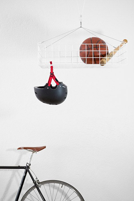Design graduate Jordi Iranzo has created the storage system Dalt for small living areas. It is suspended from the ceiling so it doesn't take up any floor or wall space.