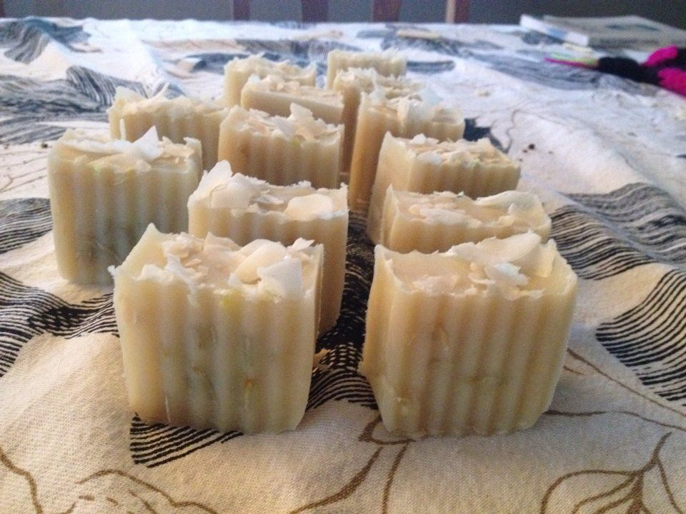 Cold press coconut scented soap with coconut flakes.