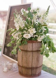 Love Now If Only I Had Some Barrels Rustic Flower Arrangements Wedding Themes Rustic Country Theme Wedding