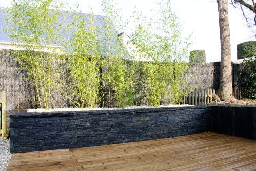 Création du0027un mur en pierre sèche en ardoise servant de jardinière - comment construire sa piscine en parpaing