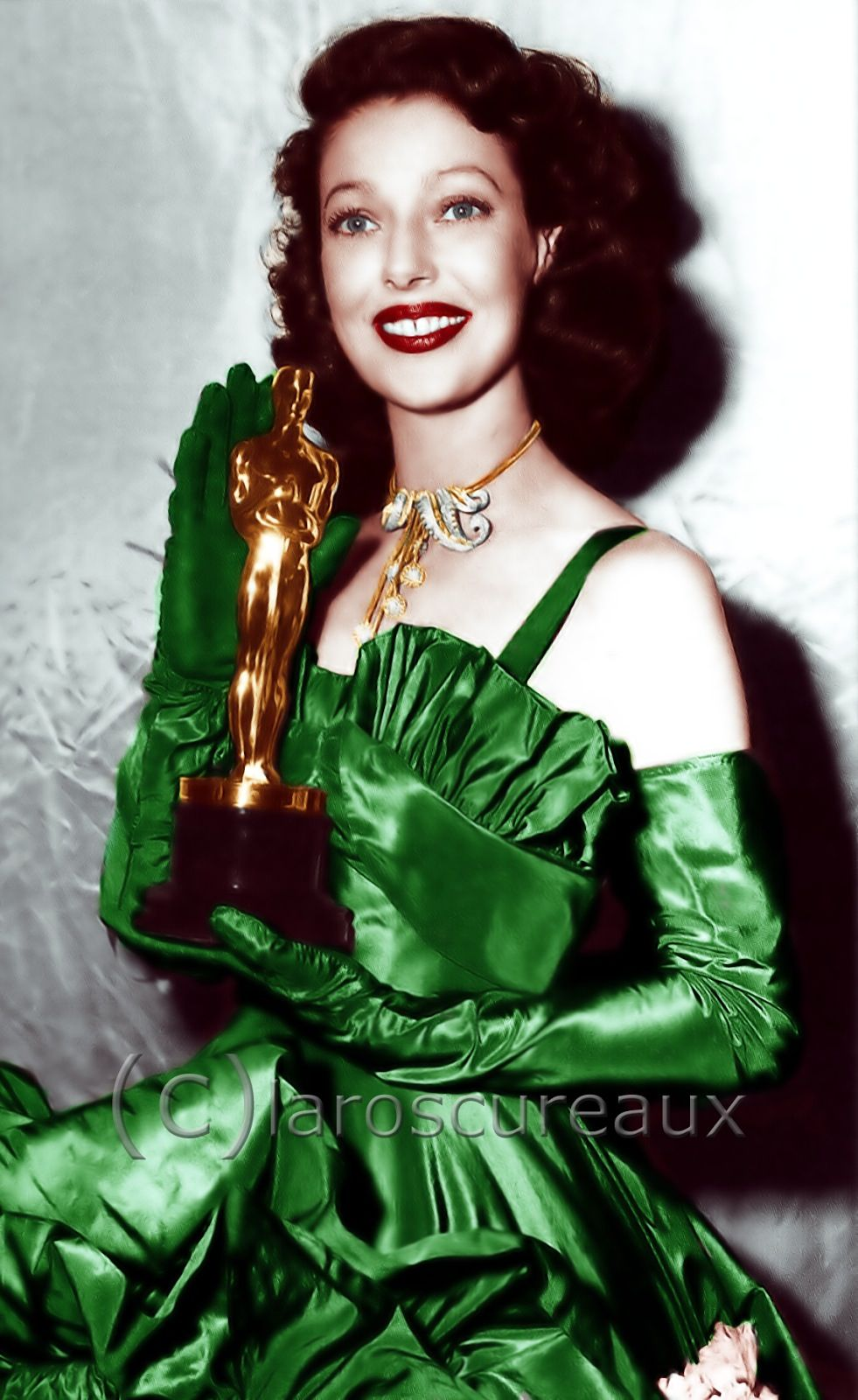 "Loretta Young - Best Actress Oscar for ""The Farmers Daughter"" 1947  Wearing an emerald green satin gown by Adrian."