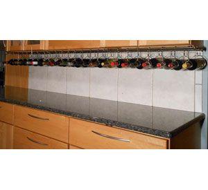 Wine bottles lining bottom of cabinets - under cabinet wine rack ...