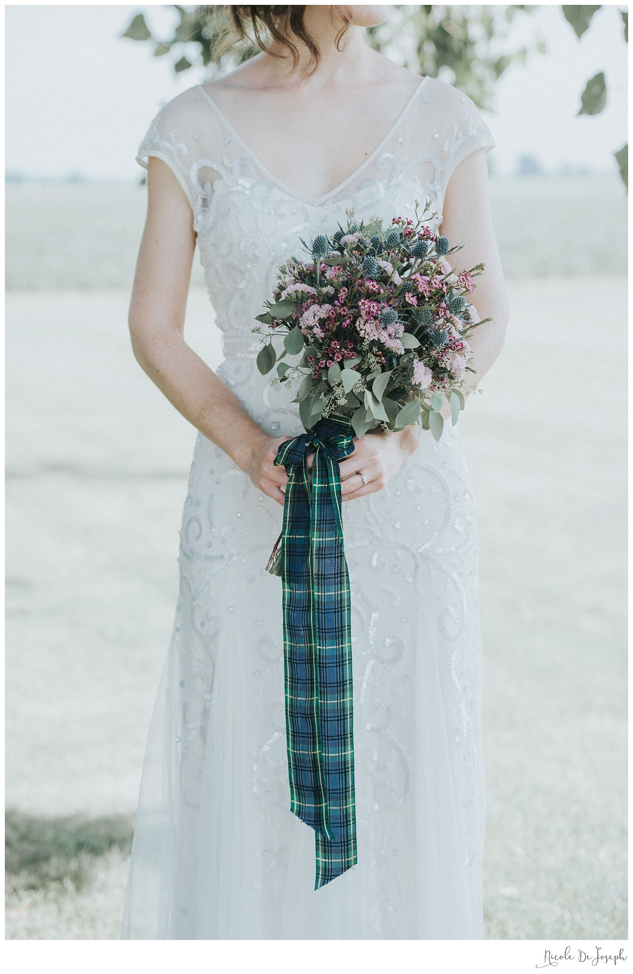 Wildflower bridal bouquet tied with her grandmother\'s highland ...