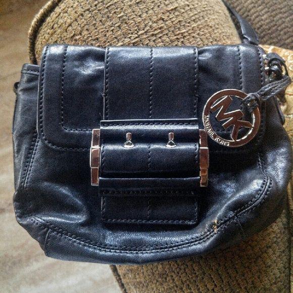 Michael Kors Black Leather Crossbody Super stylish MK leather Crossbody w/tan signature liner & goldtone hardware. Comes with MK charm. Very nice condition inside & out# Michael Kors Bags Crossbody Bags