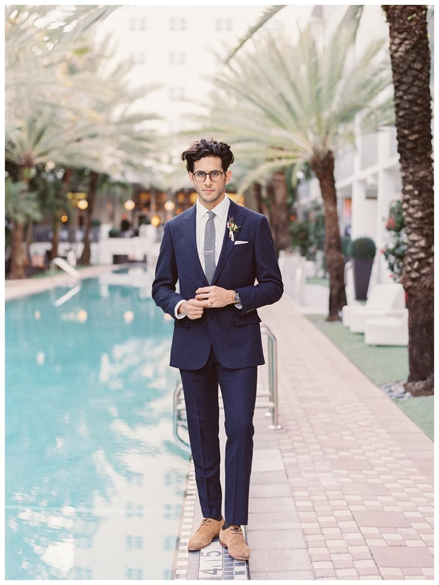 Groom style: Modern navy pinstripe suit by J.Crew. Photographed at ...