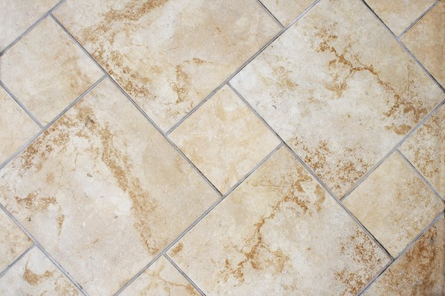 How To Reuse Ceramic Tiles Remove Mortar Hunker Tile Removal Ceramic Shower Tile Ceramic Floor Tile
