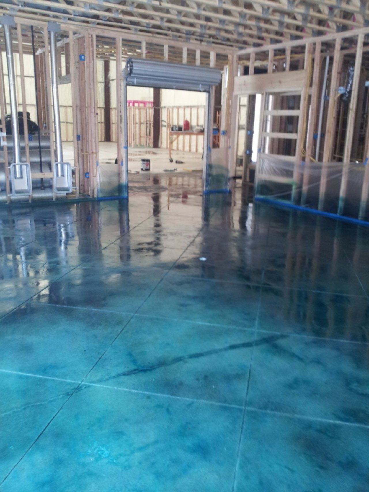 Turquoise Stained Concrete Floor In Warehouse Magnolia Texas