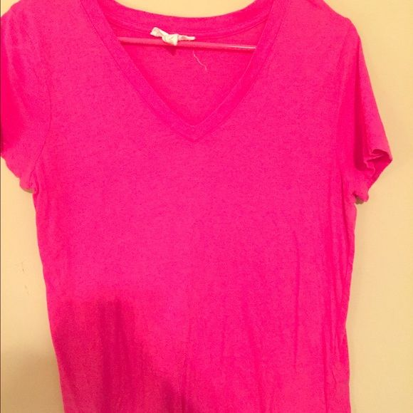 pink t shirt Adorable HOT pink v neck! Only worn once. Would be so cute with jeans or shorts. Forever 21 Tops Tees - Short Sleeve