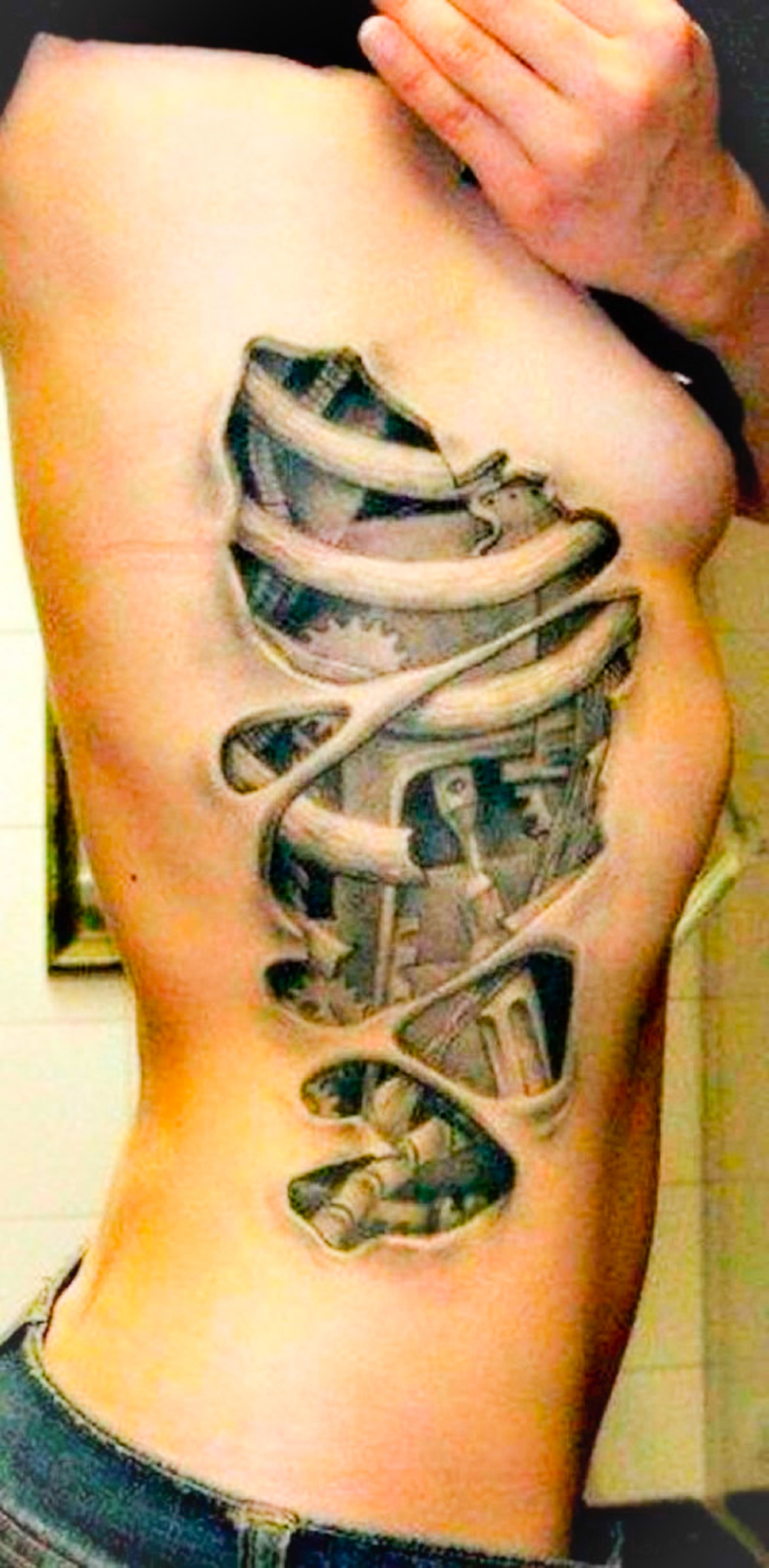 Biomechanical tattoo of rib side gears black grey for Initial tattoos on ribs