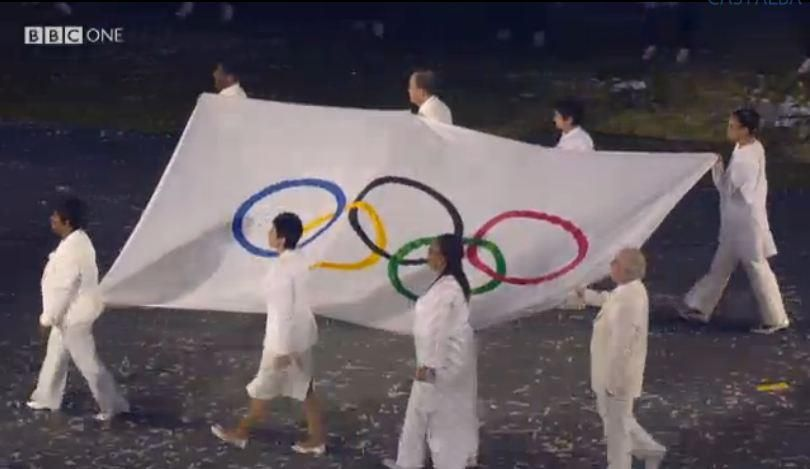At 12:18 AM - The Olympic Flag arrives in London