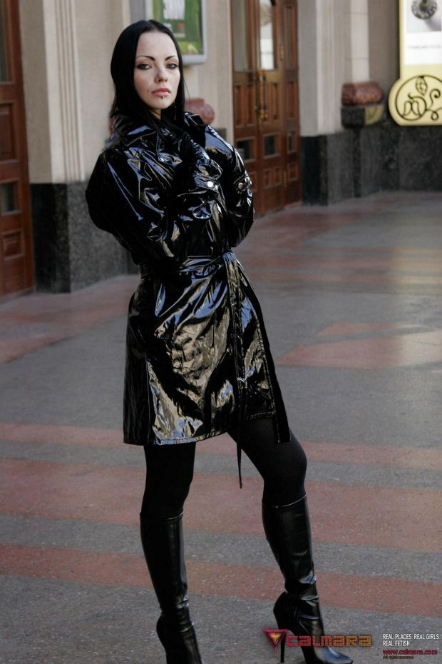 Girl In A Shiny Black Pvc Trench Coat And High Heel Boots -6656