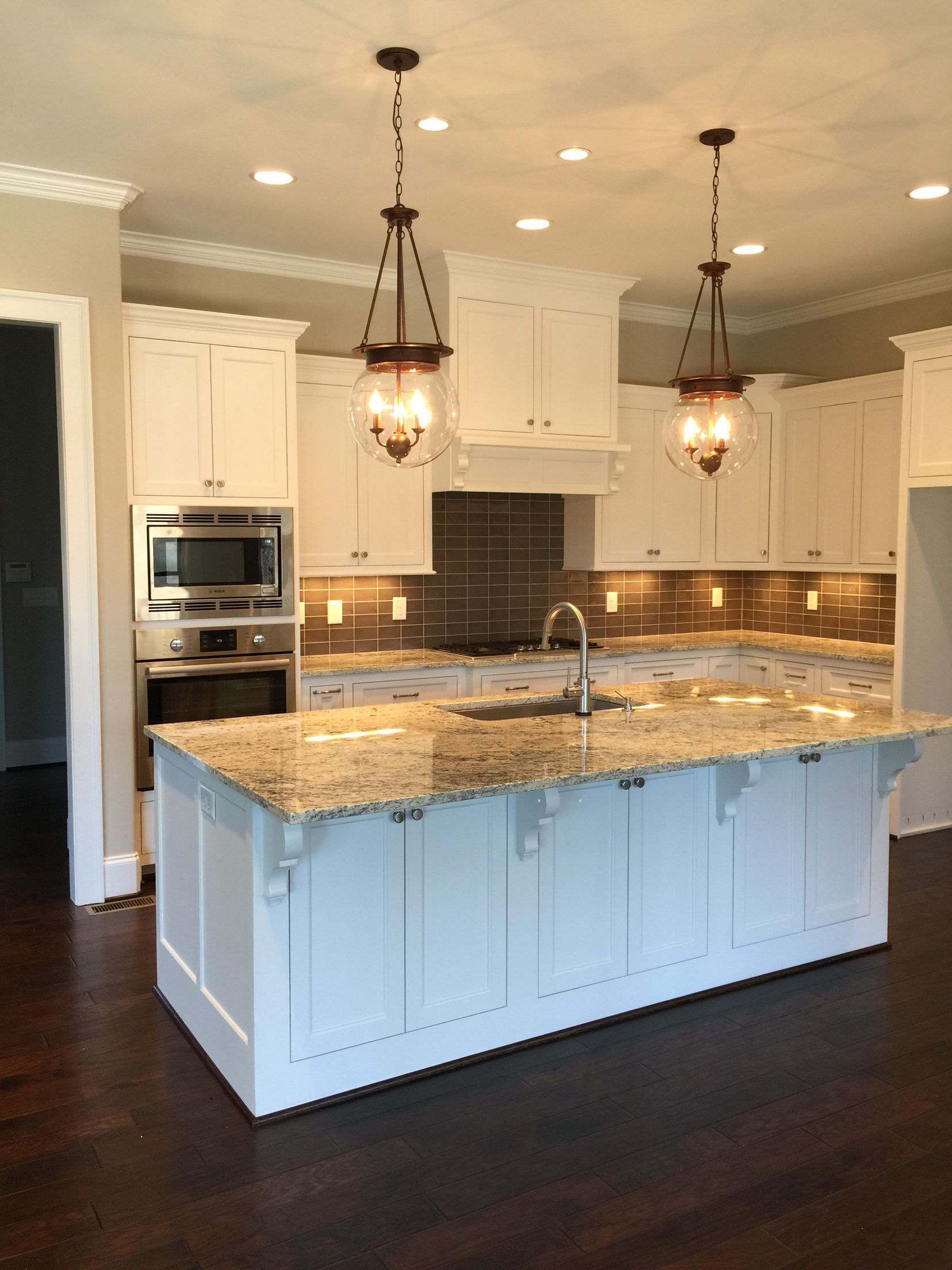 Sherwin Williams Pure White Cabinets Worldly Gray Walls White Ice Granite Dark Gray S Kitchen Cabinets Grey And White Kitchen Remodel White Kitchen Cabinets