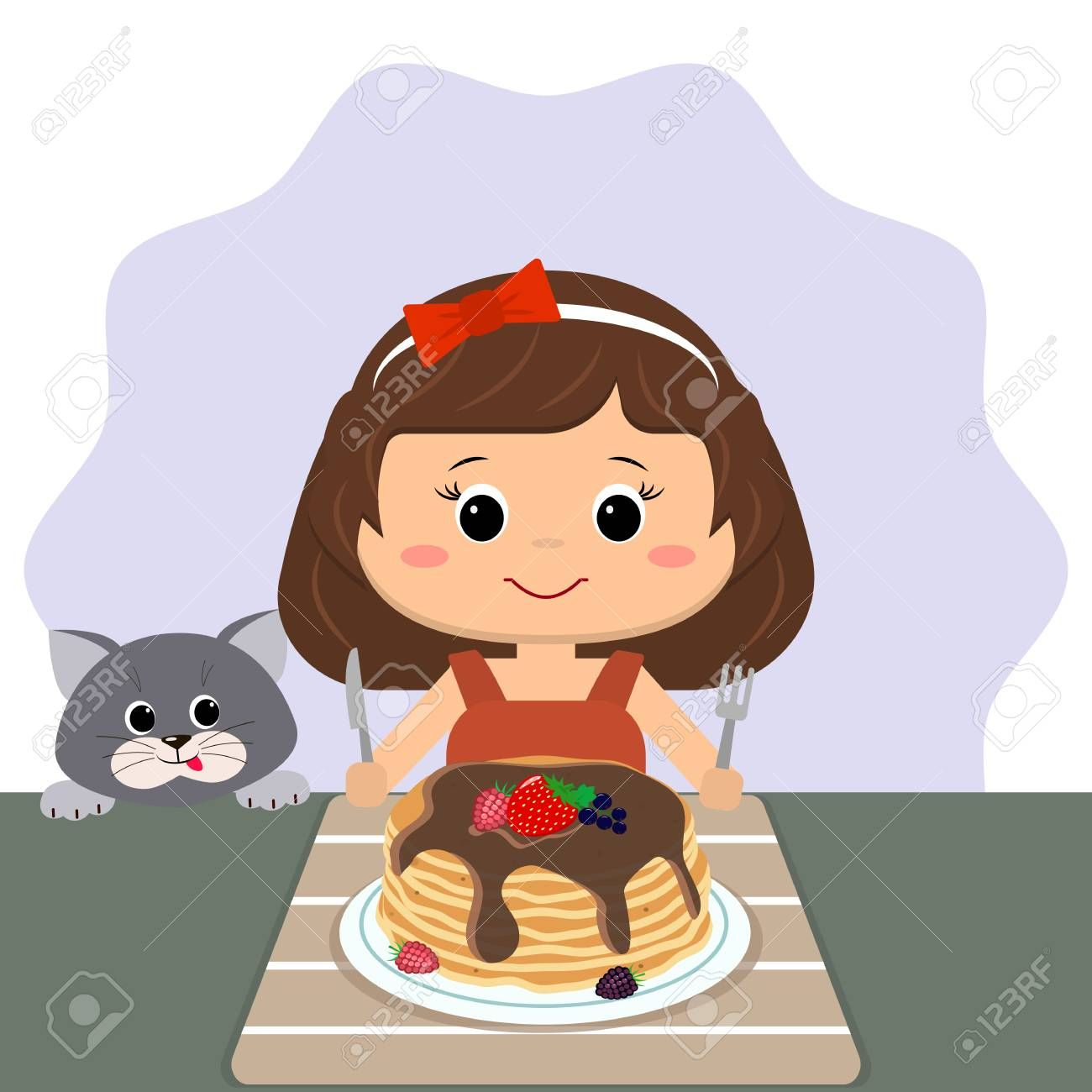 The girl is sitting at the table eating pancakes, the cat