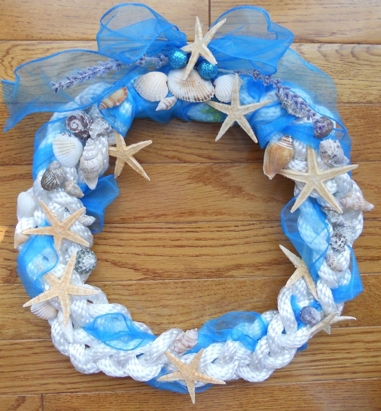 Photo of Items similar to SEASIDE NAUTICAL WREATH, Handcrafted Decor, Starfish, Shells on Etsy