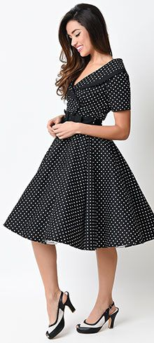 We're over the moon for Eva Marie! A bewitching jet black swing dress that beams retro charm, modeled after the divine vintage dresses of the 1950s. Boasting a fabulous button up v-neckline with a white portrait collar, ruched three-quarter length sleeves and effortless A-line circle swing skirt. Cast in a sturdy and supple cotton that lends flattering form and versatility, while gathering in the bust and a covert side zipper top off this beguiling beauty! <br /> <a…