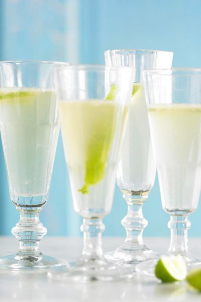Put a twist on classic margaritas by adding sparkling wine to your next batch. This simple champagne cocktail will have you wondering why you didn't always make margaritas bubbly in the first place. #champagnecocktails #holidaycocktails #wintercocktails #easycocktailrecipes #drinkrecipes #bhg