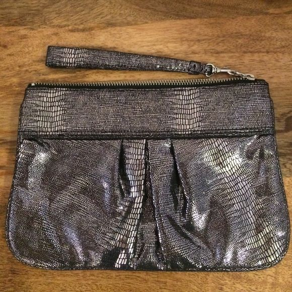 """Silver clutch This metallic wristlet is 9.5"""" by 6.5"""". It's perfect to dress up any outfit! It was only used once. Express Bags Clutches & Wristlets"""