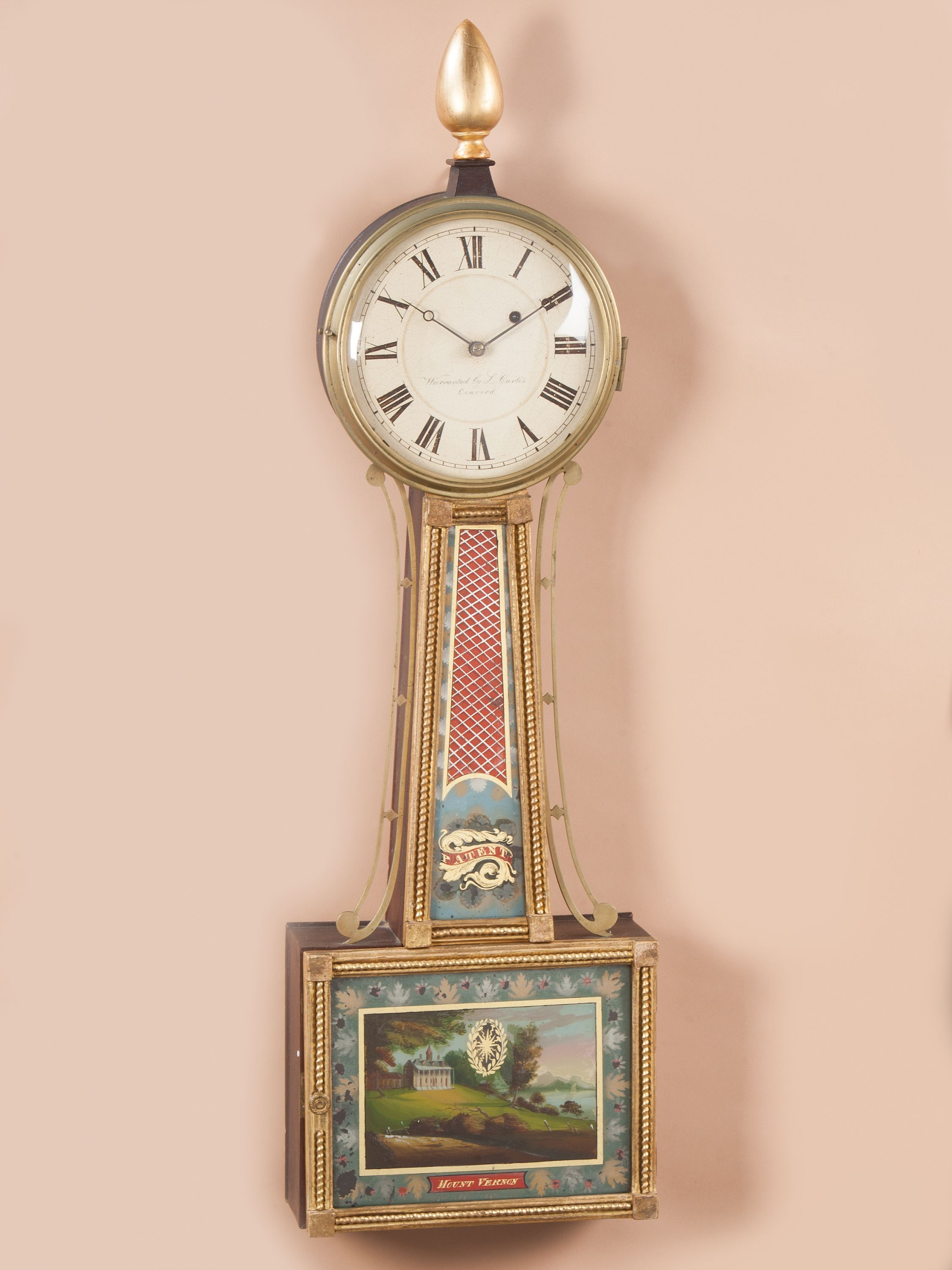 FEDERAL BANJO CLOCK WITH THE SCENE OF MOUNT VERNON ON ITS LOWER GLASS, Lemuel Curtis, Concord, Massachusetts, ca. 1815. Frank Levy Antiques. Primary Wood: Mahogany Secondary Wood: Pine Height: 34 inches Width: 9 inches
