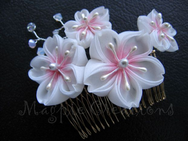 Custom order for a bride; silk habotai petals are hand-dyed and there are silver wire branches with Swarovski crystals. You can see more of my kanzashi here: