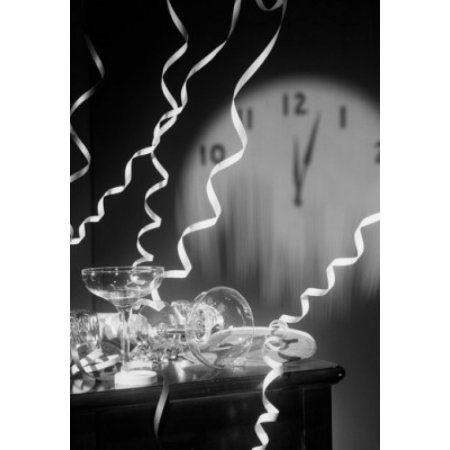 Empty champagne flutes with streamers and clock face showing five past midnight Canvas Art - (18 x 24)